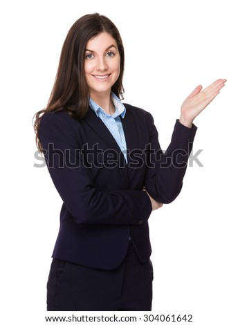 Caucasian businesswoman with hand showing something