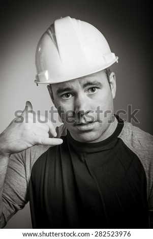 Caucasian contractor male 40 years old shot in studio isolated on grey background, black and white image - stock photo