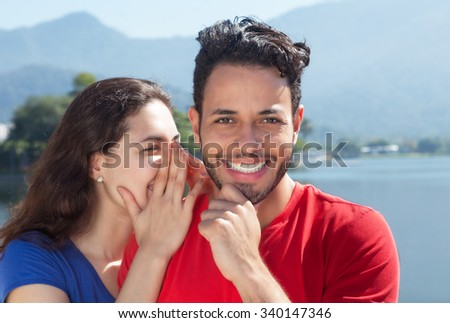 Caucasian couple in vacation has a secret - stock photo