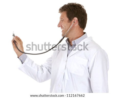 caucasian doctor is listening using stethoscope on white background