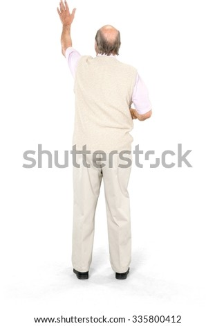 Caucasian elderly man with short grey hair in casual outfit using holographic interface - Isolated