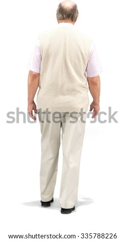 Caucasian elderly man with short grey hair in casual outfit walking - Isolated