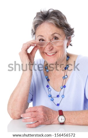 Caucasian elderly woman wearing glasses, isolated over white background.  - stock photo