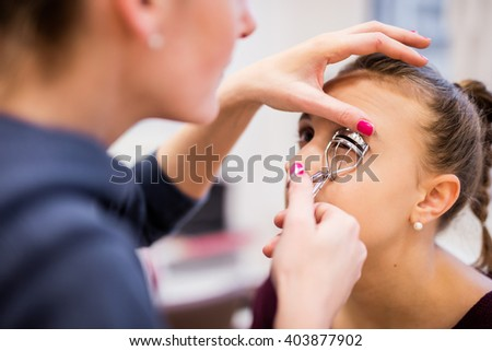 Caucasian European Athlete getting makeup done before a photoshoot - stock photo
