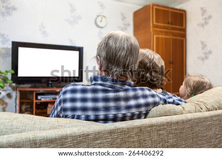 Caucasian family sitting on the couch and watching tv at home, isolated white background, rear view