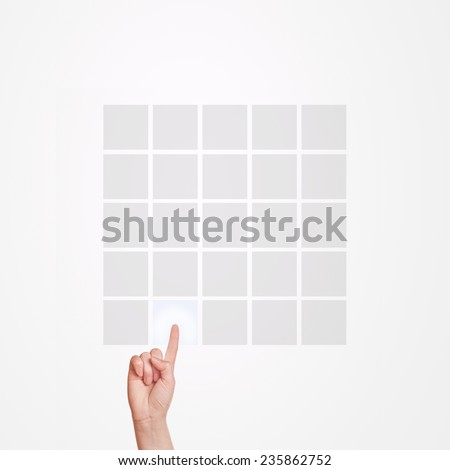 Caucasian female hand pressing 5x5 matrix touchscreen button with index finger. - stock photo