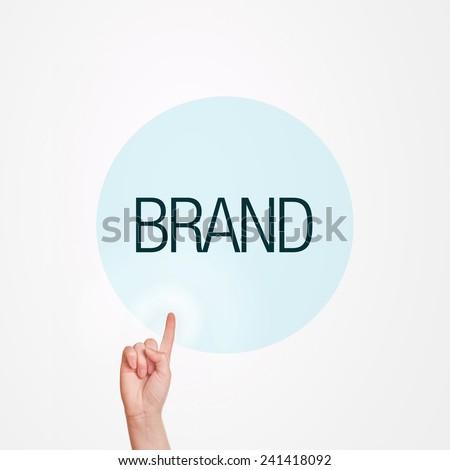 Caucasian female hand pushing Brand button. Concept of brand awareness. - stock photo