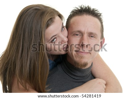 Caucasian female kissing her boyfriend - stock photo
