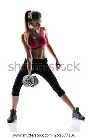 Caucasian female model with muscular fit and slim body / photo set of sporty muscular female brunette girl wearing sports clothes working out with dumbbell over white background   - stock photo