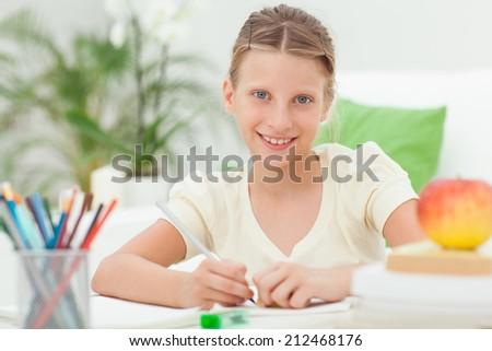 Caucasian girl doing homework after school. - stock photo