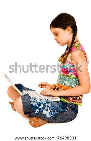 Caucasian girl using a laptop and posing isolated over white - stock photo
