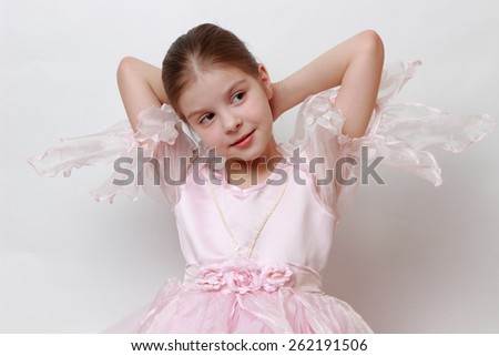 Caucasian girl wearing pink dress as a princess - stock photo