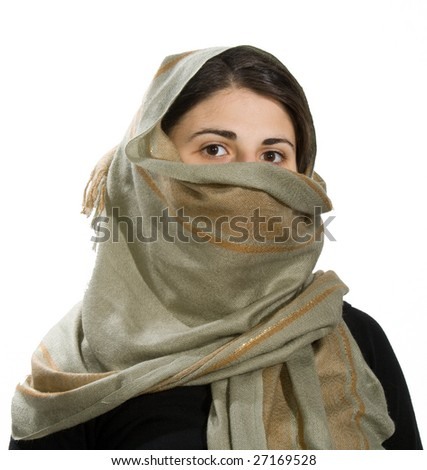 caucasian girl with scarf covered face - stock photo