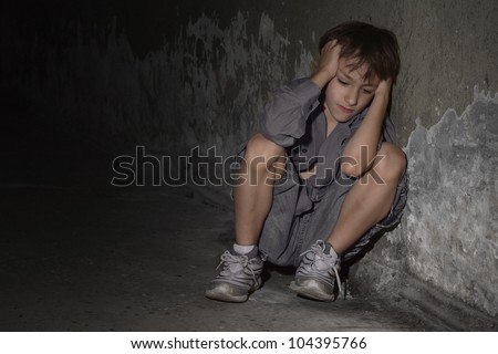 Caucasian guy frustrated sitting in a deserted place - stock photo