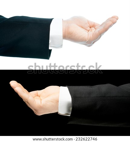Caucasian hand in a business suit, opened palm gesture sign, set of two versions, isolated over the white and black background - stock photo