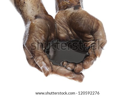 Caucasian hands cupped with black heavy fuel isolated on white background - stock photo