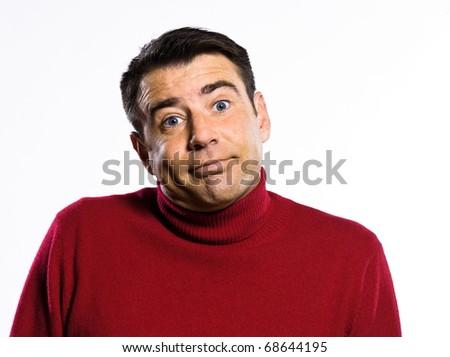 caucasian ignorant man Shrugging pouting puckering studio portrait on isolated white background - stock photo