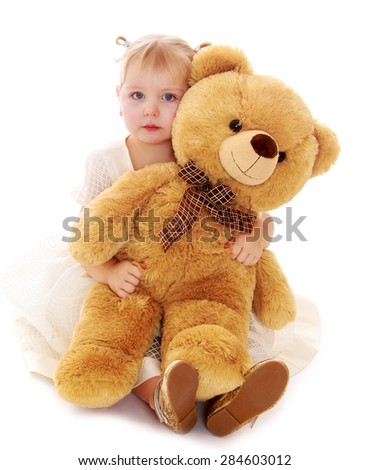 Caucasian little girl hugging a big Teddy bear- isolated on white background - stock photo