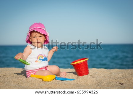Caucasian little girl playing with bach toys