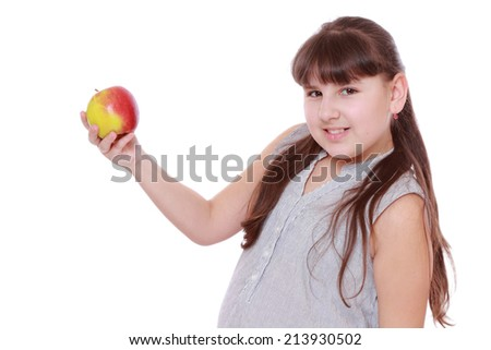 caucasian little girl with apple isolated over white