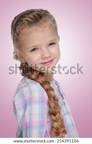 Caucasian little girl with beautiful long braid on white background - stock photo