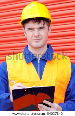 Caucasian male engineer writing his report at work