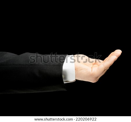Caucasian male hand in a business suit, showing the asking for help gesture sign, low-key lighting composition, isolated over the black background - stock photo