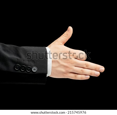 Caucasian male hand in a business suit, showing the dog gesture sign, low-key lighting composition, isolated over the black background - stock photo