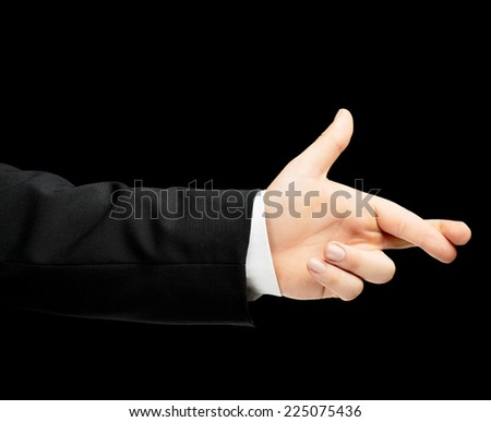 Caucasian male hand in a business suit, showing the two crossed fingers for luck gesture sign, low-key lighting composition, isolated over the black background - stock photo
