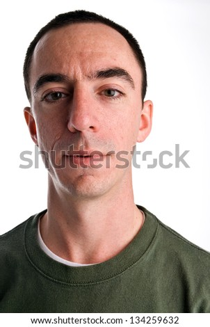 Caucasian Male Headshot Looking Forward with a Bit of a Smirk on his Face - stock photo