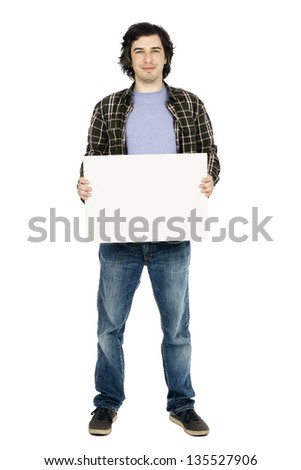 Caucasian male in his early 30's dressed in a casual attire and holding a large blank white sign, looking at the camera with a toothless. Isolated on white background. - stock photo