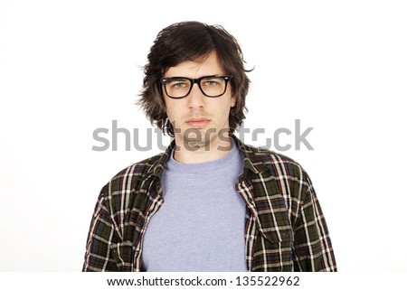 Caucasian male in his early 30's dressed in a casual attire, looking at the camera with a serious expression. Isolated on white background. - stock photo
