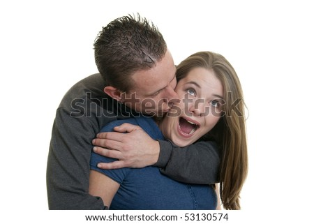 Caucasian male kissing his girlfriend - stock photo