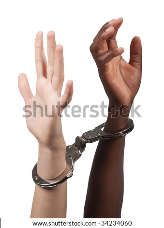 Caucasian man and African American woman handcuffed together - stock photo
