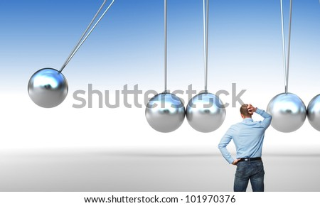 caucasian man and cradle with miss ball - stock photo