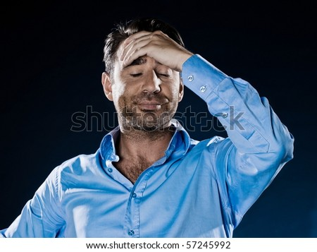 caucasian man distraught unshaven portrait isolated studio on black background - stock photo