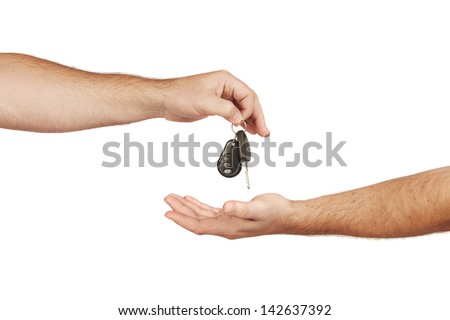Caucasian man handing over a set of car keys