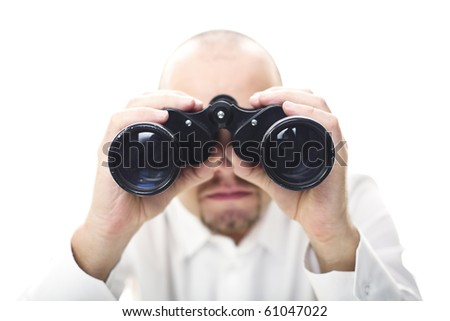 caucasian man hold binocular in his hands selective focus image - stock photo