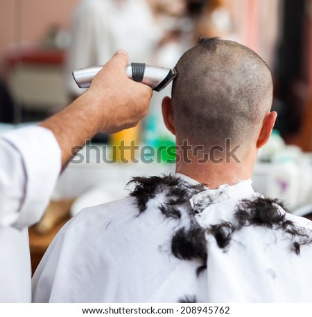 Barber Shop Alameda : Caucasian man in a barber shop getting a very short haircut - stock ...