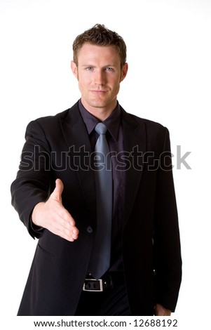 caucasian man in business suit hand shaking making a deal