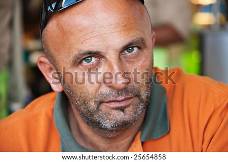 caucasian man in his forties with orange t-shirt