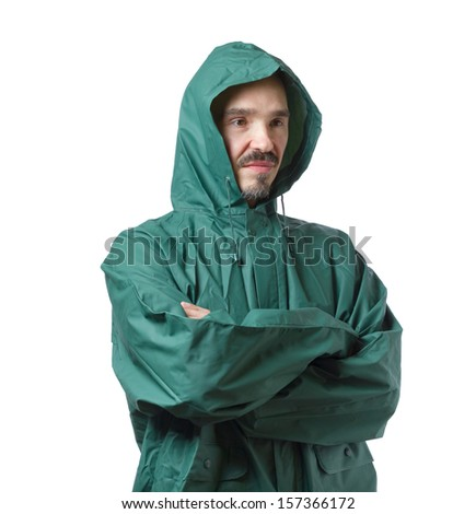 Caucasian man in hooded rain suit isolated on white background. - stock photo
