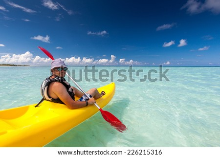 Caucasian man is kayaking in sea at Maldives  - stock photo