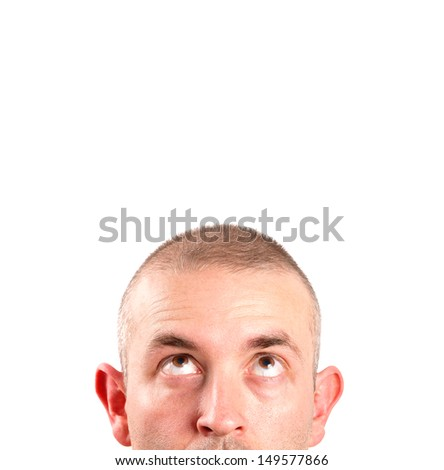 Caucasian man looking up with copy space and isolated on white background