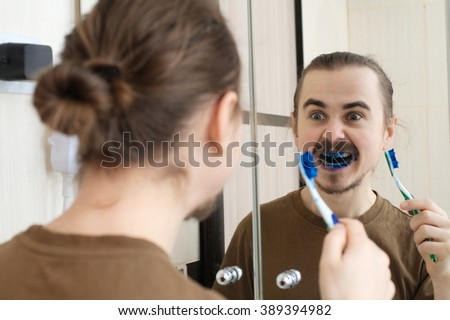Caucasian man mad about April Fools joke with tooth brush - stock photo