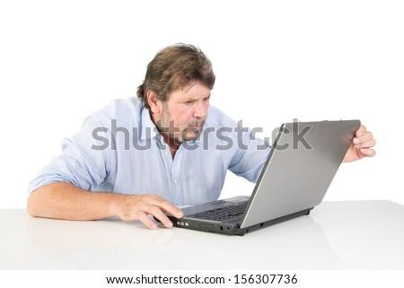 Caucasian man watching the computer - stock photo