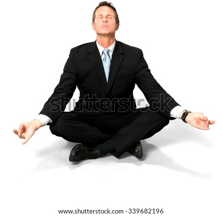 Caucasian man with short black hair in business formal outfit with meditation hands - Isolated