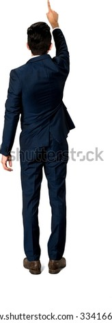 Caucasian man with short dark brown hair in business formal outfit pointing using finger - Isolated