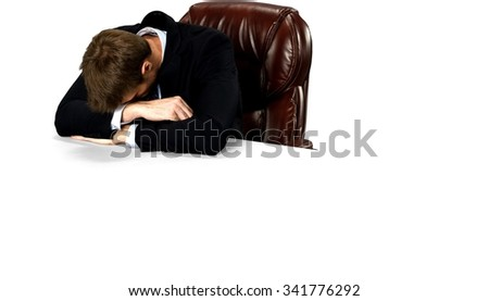 Caucasian man with short medium blond hair in business formal outfit resting on elbow - Isolated