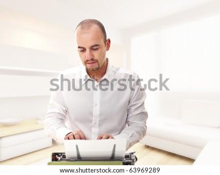 caucasian man work at typewriter at home selective focus image - stock photo